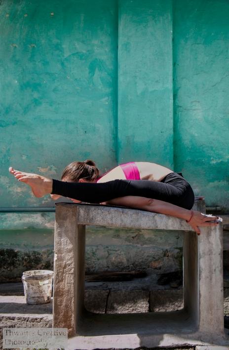 Marta Magdalena Glowacka, from Ashtanga (Mysore) Berlin demonstrating Kurmasana in Mysore India. An asana (posture) from the Ashtanga Yoga Series.